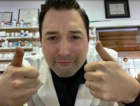 CBD expert giving two thumbs up