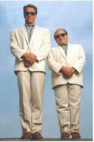 two men wearing the same style suit